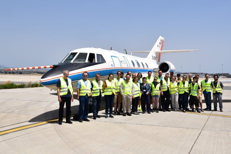 Group photo of the A-LIFE team in front of the DLR Falcon research aircraft