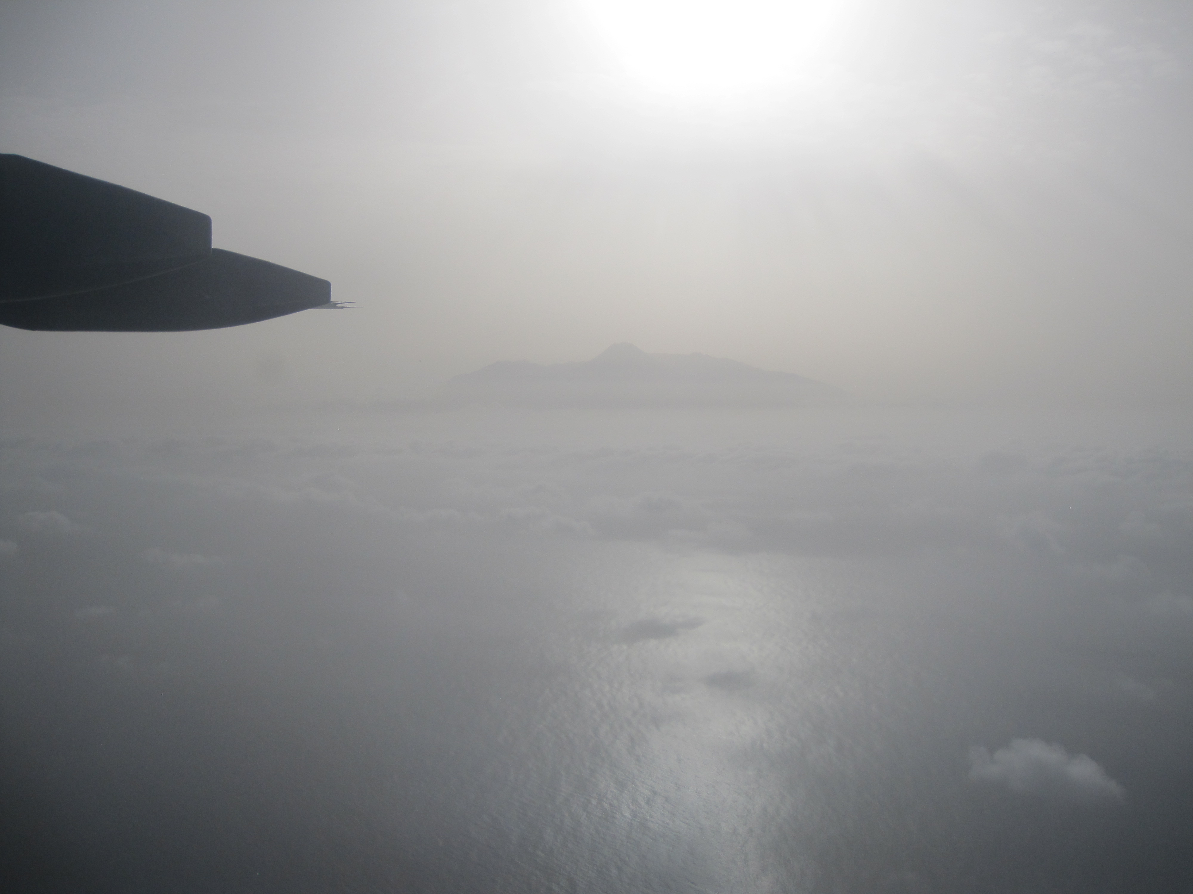 View of the Fogo Island from the flight, under the influence of a thick layer of dust - SAVEX-D Flight Campaign. Copyright Victor Estelles.